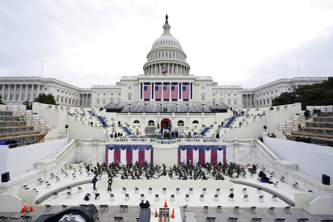 Preparations are made prior to a dress rehearsal for the 59th inaugural ceremony for President-elect Joe Biden and Vice President-elect Kamala Harris on Monday, January 18, 2021 at the U.S. Capitol in Washington. (AP Photo/Patrick Semansky, Pool)