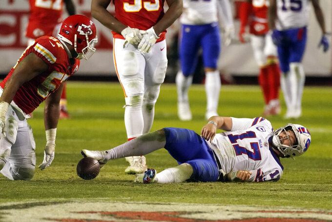 Buffalo Bills quarterback Josh Allen (17) lays on the field after being sacked during the second half of the AFC championship NFL football game by Kansas City Chiefs defensive end Alex Okafor (57) Sunday, Jan. 24, 2021, in Kansas City, Mo. (AP Photo/Charlie Riedel)