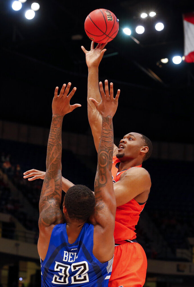 Auburn center Austin Wiley, right, shoots over Saint Louis forward KC Hankton (23) during the second half of an NCAA college basketball game Saturday, Dec. 14, 2019, in Birmingham, Ala. (AP Photo/Butch Dill)