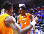 Tennessee guard Admiral Schofield (5) celebrates after the team's NCAA college basketball game against Florida on Saturday, Jan. 12, 2019, in Gainesville, Fla. Tennessee won 78-67. (AP Photo/Matt Stamey)
