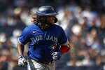 Toronto Blue Jays' Vladimir Guerrero Jr. smiles after hitting a single against the New York Yankees during the eighth inning of a baseball game on Monday, Sept. 6, 2021, in New York. (AP Photo/Adam Hunger)