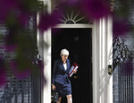 Britain's Prime Minister Theresa May leaves 10 Downing Street, for the House of Commons to attend Prime Minister's Questions, in London, Wednesday July 17, 2019. (Stefan Rousseau/PA via AP)