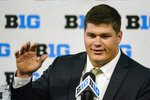 FILE - Iowa center Tyler Linderbaum talks to reporters during an NCAA college football news conference at the Big Ten Conference media days at Lucas Oil Stadium in Indianapolis, in this Friday, July 23, 2021, file photo. The move from defensive line to center pushed Iowa's Tyler Linderbaum out of his comfort zone. Linderbaum quickly adapted to the position in a program that has traditionally featured strong offensive lines. He said the offensive line's emphasis on fundamentals and drill work pushed him along. (AP Photo/Michael Conroy, File)