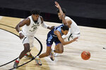 Rhode Island's Jeremy Sheppard, center, picks off the ball between South Florida's Alexis Yetna, left, and David Collins during the first half of an NCAA college basketball game Saturday, Nov. 28, 2020, in Uncasville, Conn. (AP Photo/Jessica Hill)