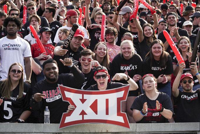 Cincinnati fans react during the first half of an NCAA college football game against Murray State, Saturday, Sept. 11, 2021, in Cincinnati. (AP Photo/Jeff Dean)