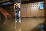Jake Nebuda removes damaged items from the basement of home Tuesday, March 19, 2019, in North Bend, Neb. The home had over 40 inches of water in it early this week. (Brendan Sullivan/The World-Herald via AP)/Omaha World-Herald via AP)