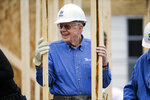 FILE - In this Nov. 2, 2015, file photo, former President Jimmy Carter works at a Habitat for Humanity building site in Memphis, Tenn. Carter is sometimes called a better former president than he was president. The backhanded compliment has always rankled Carter allies and, they say, the former president himself. Yet now, 40 years removed from the White House, the most famous resident of Plains, Georgia, is riding a new wave of attention as biographers, filmmakers, climate activists and Carter's fellow Democrats push for a recasting of his presidential legacy. (AP Photo/Mark Humphrey, File)