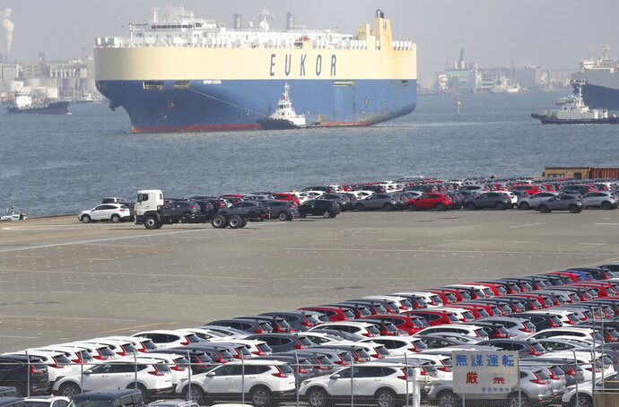 In this March 5, 2019, photo, cars for export park at a port in Yokohama, near Tokyo. Government data show Japan's exports fell for the eighth straight month in July as worries continued about President Donald Trump's trade policies denting Asian economic growth. (AP Photo/Koji Sasahara)