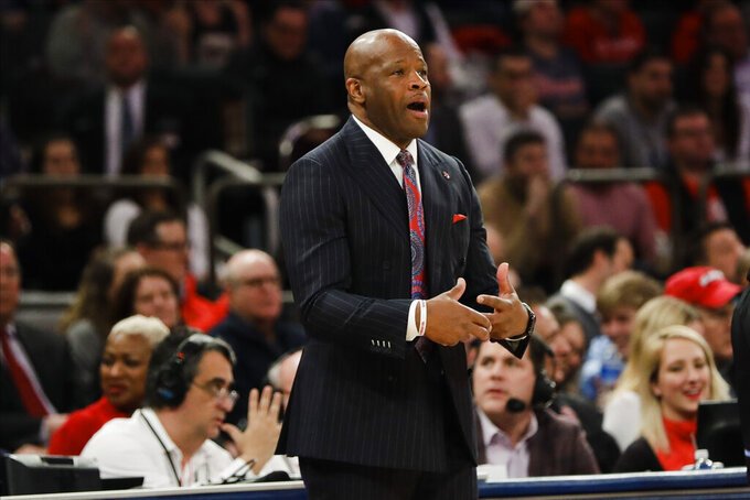 St. John's head coach Mike Anderson calls out to his team during the first half of an NCAA college basketball game against Villanova Tuesday, Jan. 28, 2020, in New York. (AP Photo/Frank Franklin II)