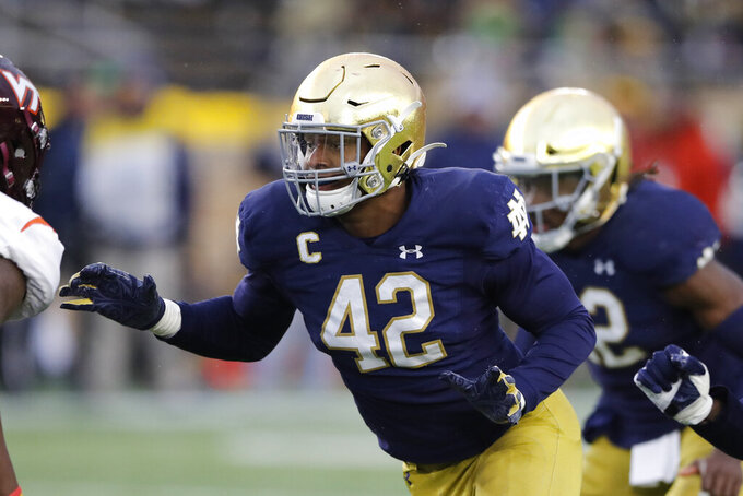 FILE - In this Nov. 2, 2019, file photo, Notre Dame defensive lineman Julian Okwara (42) in action during the second half of an NCAA college football game against Virginia Tech in South Bend, Ind. Okwara was selected by the Detroit Lions in the third round of the NFL football draft Friday, April 24, 2020. (AP Photo/Carlos Osorio, File)