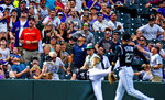 Colorado Rockies second baseman Ryan McMahon (24) falls into the crowd while trying to catch a ball in the fifth inning of a baseball game against the San Diego Padres, Sunday, Sept. 15, 2019, in Denver. (AP Photo/Parker Seibold)