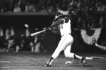 FILE - In this April 8, 1974, file photo, Atlanta Braves' Hank Aaron hits his 715th career home run in Atlanta Stadium to break the all-time record set by Babe Ruth. Hank Aaron, who endured racist threats with stoic dignity during his pursuit of Babe Ruth but went on to break the career home run record in the pre-steroids era, died early Friday, Jan. 22, 2021. He was 86. The Atlanta Braves said Aaron died peacefully in his sleep. No cause of death was given. (AP Photo/Joe Holloway, Jr., File)