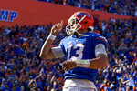Florida quarterback Feleipe Franks (13) shushes the crowd after scoring a touchdown against South Carolina during an NCAA college football game, Saturday, Nov. 10, 2018, in Gainesville, Fla. (Lauren Bacho/The Gainesville Sun via AP)