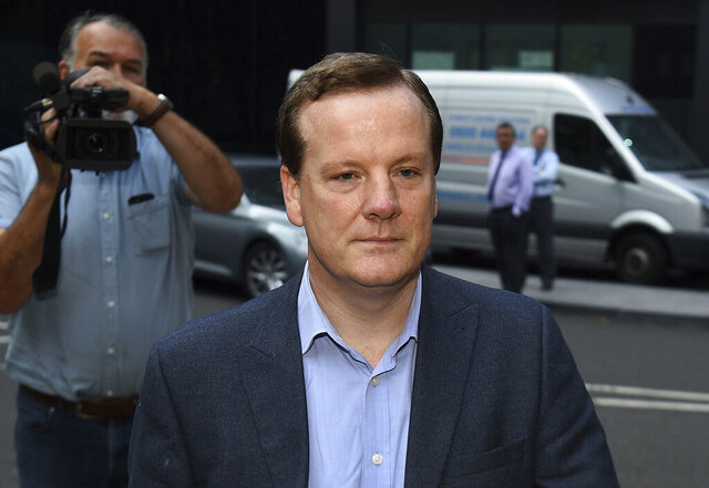 Former Conservative Party lawmaker Charlie Elphicke arrives at Southwark Crown Court in London to be sentenced on three counts of sexual assault, Tuesday Sept. 15, 2020. Elphicke has been sentenced to two years in prison on Tuesday for sexually assaulting two women a decade apart. (Kirsty O'Connor/PA via AP)