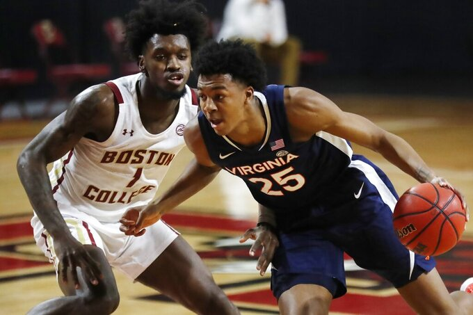 Virginia's Trey Murphy III (25) drives past Boston College's CJ Felder (1) during the first half of an NCAA college basketball game, Saturday, Jan. 9, 2021, in Boston. (AP Photo/Michael Dwyer)