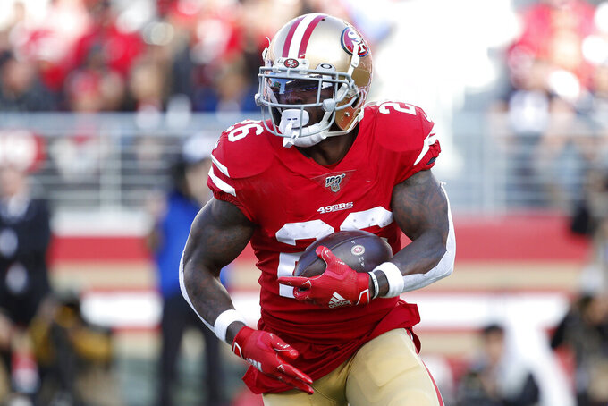 San Francisco 49ers running back Tevin Coleman (26) runs against the Atlanta Falcons during the first half of an NFL football game in Santa Clara, Calif., Sunday, Dec. 15, 2019. (AP Photo/Josie Lepe)