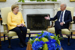 FILE - In this July 15, 2021, file photo President Joe Biden meets with German Chancellor Angela Merkel in the Oval Office of the White House in Washington. The United States and Germany have reached a deal that will allow the completion of a controversial Russian gas pipeline to Europe without the imposition of further U.S. sanctions, a senior U.S. official said Wednesday, July 21. (AP Photo/Evan Vucci, File)