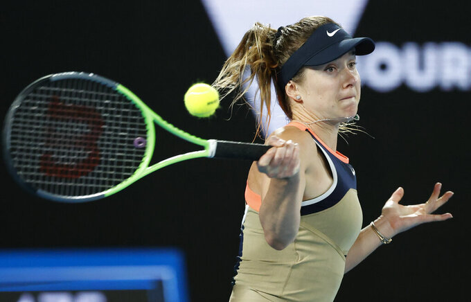 Ukraine's Elina Svitolina makes a forehand return to United States' Coco Gauff during their second round match at the Australian Open tennis championship in Melbourne, Australia, Thursday, Feb. 11, 2021.(AP Photo/Rick Rycroft)