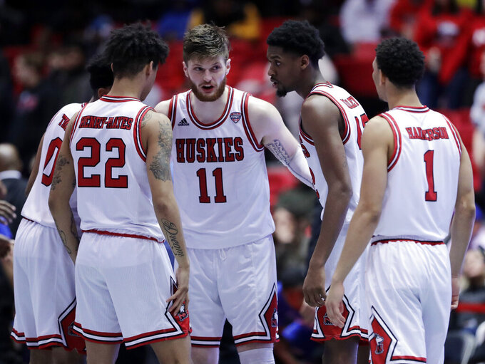 Northern Illinois forward Noah McCarty (11) talks to his teammates during the second half of an NCAA college basketball game against Buffalo, Tuesday, Jan. 22, 2019, in DeKalb, Ill. Northern Illinois won 77-75. (AP Photo/Nam Y. Huh)