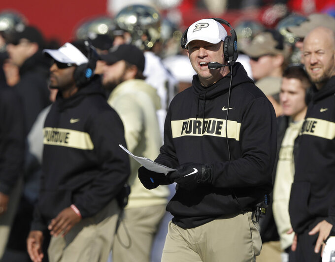 FILE - In this Nov. 24, 2018, file photo, Purdue coach Jeff Brohm watches his team play Indiana during an NCAA college football game in Bloomington, Ind. One day after reportedly meeting with Louisville officials in central Indiana, Brohm informed Boilermakers athletic director Mike Bobinski he was turning down the Cardinals job so he could stay in West Lafayette. (AP Photo/Darron Cummings, File)