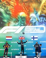 Winner Mercedes driver Lewis Hamilton of Britain, center, celebrates on the podium flanked by second placed Red Bull driver Max Verstappen of the Netherlands, left, and third placed Mercedes driver Valtteri Bottas of Finland after the Formula One Grand Prix at the Barcelona Catalunya racetrack in Montmelo, Spain, Sunday, Aug. 16, 2020. (Alejandro Garcia, Pool via AP)