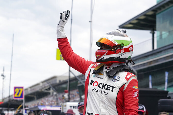Simona De Silvestro, of Switzerland, waves to fans during qualifications for the Indianapolis 500 auto race at Indianapolis Motor Speedway, Sunday, May 23, 2021, in Indianapolis. (AP Photo/Darron Cummings)
