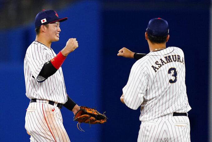 Japan's Munetaka Murakami, left, and Hideto Asamura celebrate after a semi-final baseball game against South Korea at the 2020 Summer Olympics, Wednesday, Aug. 4, 2021, in Yokohama, Japan. Japan won 5-2. (AP Photo/Matt Slocum)