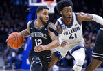Providence guard Luwane Pipkins (12) moves past Villanova forward Saddiq Bey (41) during the second half of an NCAA college basketball game, Saturday, Feb. 29, 2020, in Philadelphia, Pa. Providence won 58-54. (AP Photo/Laurence Kesterson)