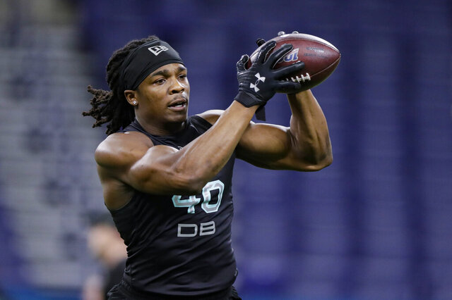 FILE - In this March 1, 2020, file photo, Lenoir-Rhyne defensive back Kyle Dugger runs a drill at the NFL football scouting combine in Indianapolis. Dugger made Hickory, North Carolina, a must stop for NFL scouts last fall.  (AP Photo/Michael Conroy)