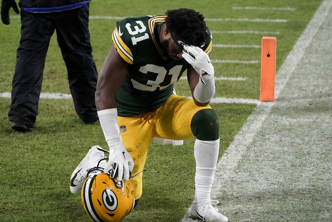 Green Bay Packers' Adrian Amos pauses after losing the NFC championship NFL football game to the Tampa Bay Buccaneers in Green Bay, Wis., Sunday, Jan. 24, 2021. The Buccaneers defeated the Packers 31-26 to advance to the Super Bowl. (AP Photo/Morry Gash)