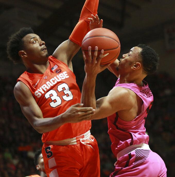 Virginia Tech's Justin Robinson (5) shoots and is fouled by Syracuse's Elijah Hughes (33) during an NCAA college basketball game in Blacksburg, Va., Saturday, Jan. 26, 2019. (Matt Gentry/The Roanoke Times via AP)