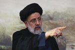 FILE - In this June 6, 2021 file photo, Presidential candidate Ebrahim Raisi, points during a campaign rally in Eslamshahr, southwest of Tehran, Iran. The presidential election on Friday, June 18, is likely to be a coronation for Raisi, a hard-line candidate long cultivated by Supreme Leader Ayatollah Ali Khamenei. (AP Photo/Vahid Salemi, File)
