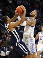 DePaul guard Devin Gage, right, drives as Butler guard Aaron Thompson defends during the second half of an NCAA college basketball game Wednesday, Jan. 16, 2019, in Chicago. Butler won 87-69. (AP Photo/Nam Y. Huh)
