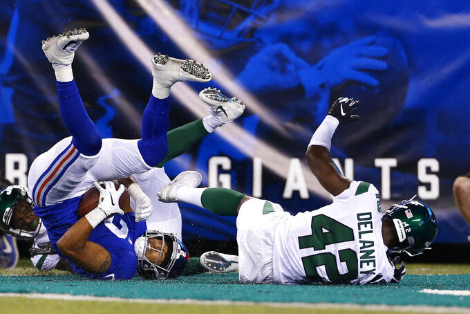 New York Giants kicker Aldrick Rosas (2) catches a pass for a touchdown next to New York Jets cornerback Dee Delaney during the second half of a preseason NFL football game Thursday, Aug. 8, 2019, in East Rutherford, N.J. (AP Photo/Adam Hunger)