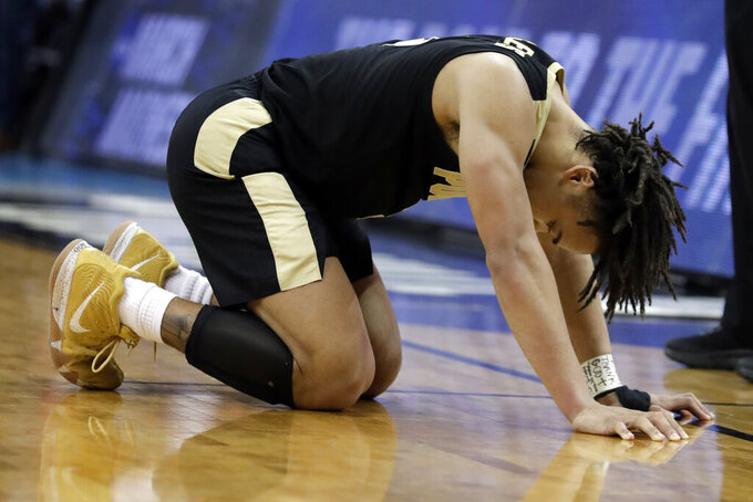 Purdue's Carsen Edwards reacts after a Purdue turnover during overtime of the men's NCAA Tournament college basketball South Regional final game against Virginia, Saturday, March 30, 2019, in Louisville, Ky. Virginia won 80-75. (AP Photo/Michael Conroy)