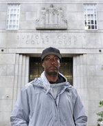 In this June 13, 2019 photo, Sean Ellis poses for a photo outside the Suffolk County Superior Court House in Boston. During the 22 years he spent in prison after being convicted of killing a Boston police detective, Ellis believed there was something suspicious about the officers who led the murder investigation. He just couldn't prove it. It would take years of digging and scores of public information requests from his attorneys to uncover evidence that several officers investigating the 1993 murder case were involved in criminal activity, information that wasn't shared with the defense. (AP Photo/Charles Krupa)