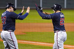 Atlanta Braves' Adam Duvall (23) is congratulated by Austin Riley (27) after his two-run home run off Boston Red Sox pitcher Mike Kickham during the second inning of a baseball game Wednesday Sept. 2, 2020, in Boston. (AP Photo/Charles Krupa)