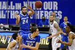Creighton's Mitch Ballock (24) passes to Ryan Kalkbrenner (32) during the second half of an NCAA college basketball game against the Seton Hall Wednesday, Jan. 27, 2021, in Newark, N.J. Creighton won 85-81. (AP Photo/Frank Franklin II)