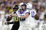 TCU quarterback Max Duggan (15) prepares to throw a pass against Purdue during the second half of an NCAA college football game in West Lafayette, Ind., Saturday, Sept. 14, 2019. (AP Photo/Michael Conroy)