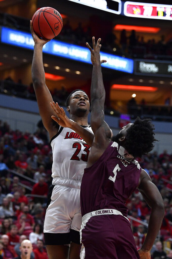 Louisville center Steven Enoch (23) shoots over the defense of Eastern Kentucky forward Darius Hicks (5) during the second half of an NCAA college basketball game in Louisville, Ky., Saturday, Dec. 14, 2019. Louisville won 99-67. (AP Photo/Timothy D. Easley)