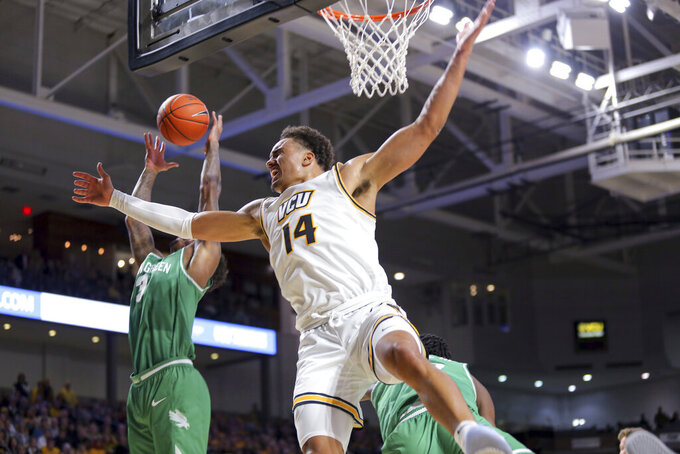 VCU's Marcus Santos-Silva (14) fights for a rebound against North Texas' Javion Hamlet (3) during the first half of an NCAA college basketball game in Richmond, Va., Friday, Nov. 8, 2019. (AP Photo/Parker Michels-Boyce)