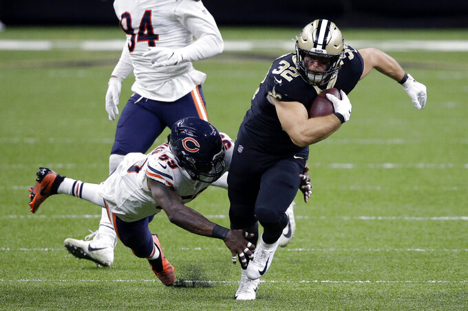 New Orleans Saints running back Michael Burton (32) carries against Chicago Bears inside linebacker Danny Trevathan (59) in the second half of an NFL wild-card playoff football game in New Orleans, Sunday, Jan. 10, 2021. (AP Photo/Butch Dill)