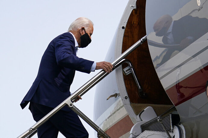 Democratic presidential candidate and former Vice President Joe Biden boards a plane at New Castle Airport in New Castle, Del., Tuesday, Sept. 15, 2020. Biden is traveling to Florida for campaign events. (AP Photo/Patrick Semansky)
