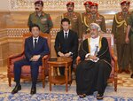 In this photo made available by Oman News Agency, Oman's Sultan Haitham bin Tariq Al Said, right, receives Japan's prime minister Shinzo Abe after his arrival in Muscat, Oman, Tuesday, Jan. 14, 2020. (Oman News Agency via AP)