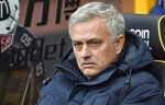 FILE - In this Sunday, Dec. 15, 2019 file photo, Tottenham's manager Jose Mourinho waits for the start of the English Premier League soccer match between Wolverhampton Wanderers and Tottenham Hotspur at the Molineux Stadium in Wolverhampton, England. José Mourinho has been hired to coach Italian club Roma starting next season. The move came a few hours after the club's American owners announced that current coach Paulo Fonseca will depart at the end of this season. Mourinho's contract is for three seasons. Mourinho previously coached in Serie A at Inter Milan. (AP Photo/Rui Vieira, File)