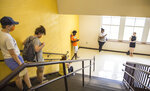 Voters join the end of the line at Peachcrest Elementary School to vote in the state's primary election, Tuesday, June 9, 2020, in Decatur, Ga. Coronavirus restrictions only allow 10 people in the gym at a time so many machines are not being used, creating long wait times.(Jenni Girtman/Atlanta Journal-Constitution via AP)
