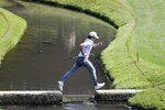 Denny McCarthy jumps across a bridge on the 14th hole during opening round of the Workday Charity Open golf tournament, Thursday, July 9, 2020, in Dublin, Ohio. (AP Photo/Darron Cummings)