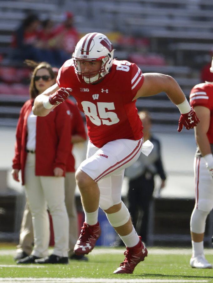 FILE - In this Sept. 9, 2017, file photo, Wisconsin's Zander Neuville warms up before an NCAA college football game against Florida Atlantic, in Madison, Wis. The offense is nearly back to full strength at No. 6 Wisconsin. Tight end Zander Neuville returned last week from injury. Receiver Danny Davis is due back from suspension this weekend. Two more targets for quarterback Alex Hornibrook when BYU visits Camp Randall Stadium on Saturday. . (AP Photo/Morry Gash, File)