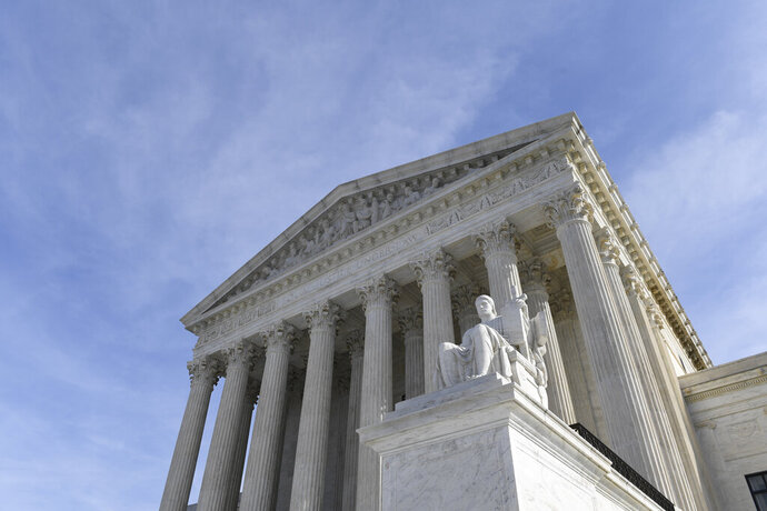 FILE - In this Nov. 11, 2019 file photo, a view of the Supreme Court in Washington.  The Supreme Court will decide whether Electoral College voters are required to support presidential candidate who wins state.  (AP Photo/Susan Walsh)