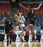 Hawaii guard Brocke Stepteau, middle, passes between Long Beach State guard Drew Cobb, left, and Jordan Roberts during first half of an NCAA college basketball game at the Big West men's tournament in Anaheim, Calif., Thursday, March 14, 2019. (AP Photo/Chris Carlson)